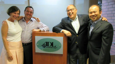 Amanda Susskind with co-chairs Murray Levin, Dan Olivas and Vincent Gonzalez. Not pictured: Brent Sokol.